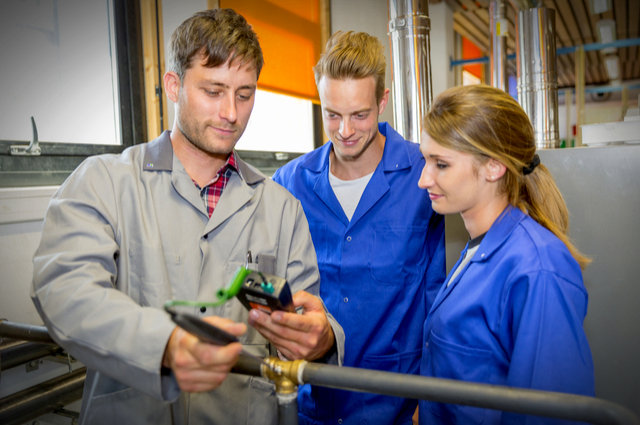 Plumbing apprentices image by Atelier211 (via Shutterstock).